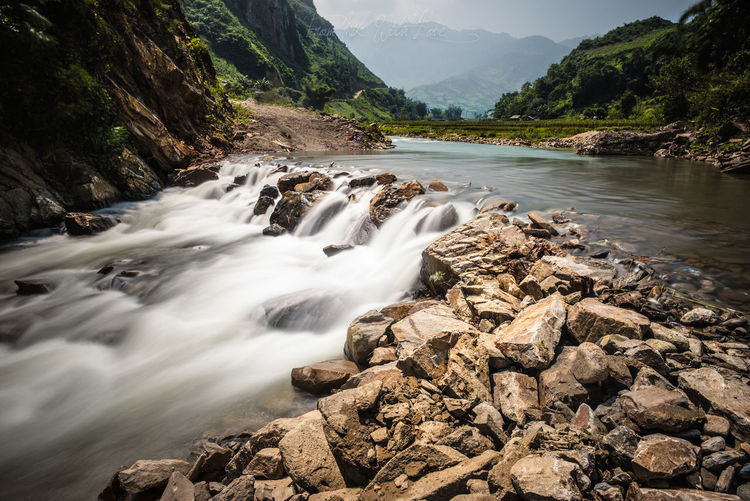Scenic view of stream flowing through rocks