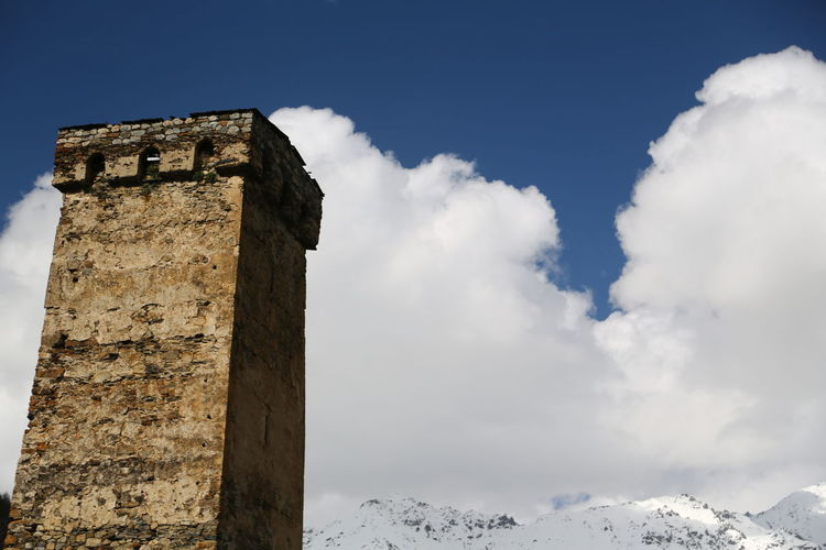Sky Cloud - Sky Architecture Built Structure History The Past Nature Low Angle View Day Building Exterior No People Building Winter Cold Temperature Snow Ancient Travel Old Travel Destinations Outdoors Ancient Civilization Georgia Mestia/town In Svaneti/Georgia