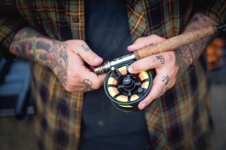 Close-up human hand holding fishing rod