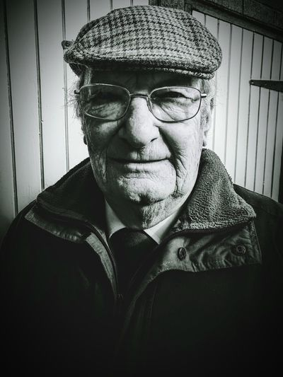 Elderly gentleman Portrait One Person Close-up Adult flat cap Glasses Looking Towards The Camera Wrinkled Face Life Lived