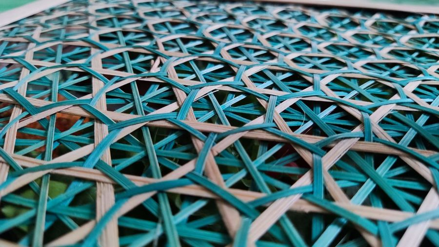 Full frame shot of patterned wall, backround green of the bamboo
