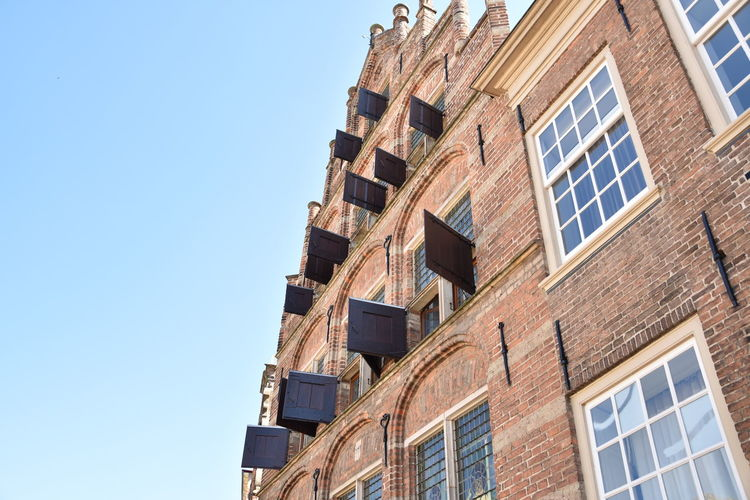 Amsterdam Apartment Architecture Blue Building Building Exterior Built Structure City Clear Sky Copy Space Day House In A Row Low Angle View Nature No People Old Buildings Outdoors Pattern Residential District Row House Sky Sunlight Window