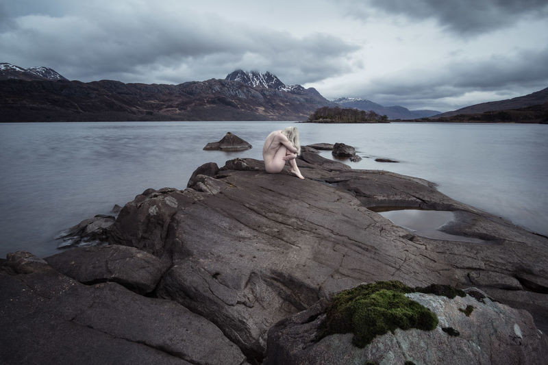 Fine Art Photograph of a woman at a lake in Scotland The Creative - 2018 EyeEm Awards The Great Outdoors - 2018 EyeEm Awards Stone Sony Wide Angle Scenics Nature Sensual_woman Female Canonphotography Loch Maree Scotland Fine Art Photography Art Blonde Girl Mountain Range Long Exposure Mountain Water Lake Cold Temperature Adventure Snowcapped Mountain Outdoor Pursuit