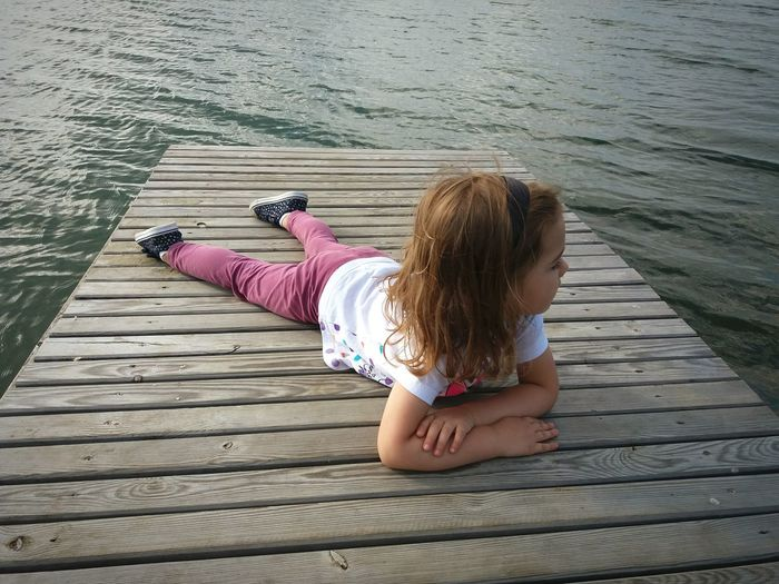 One Person Child Water Childhood Lying Down Lying On The Floor Lying On The Beach Beachside Waterfront Lake View Lakeside Lake Relaxing Time Relaxing Moments Relaxing View Little Girl Tired Quiet Quiet Moments Trip One Girl Only Children Only People Full Length Water Surface