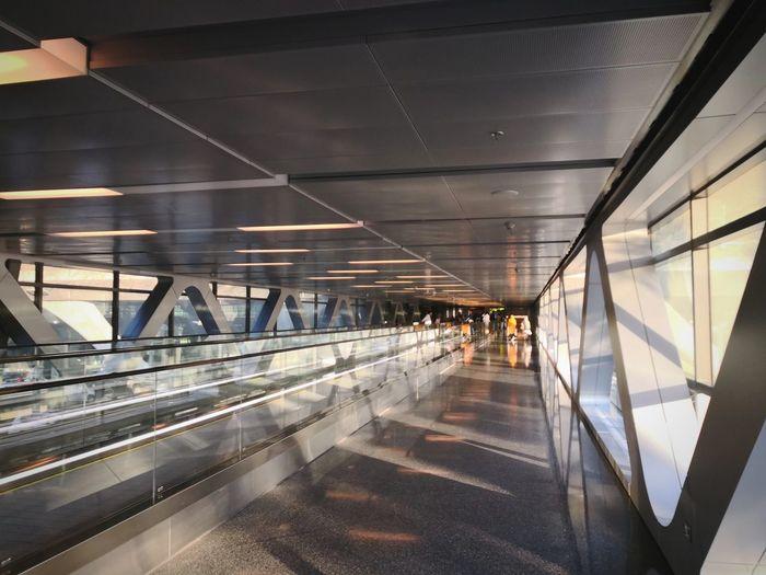 Illuminated corridor at airport