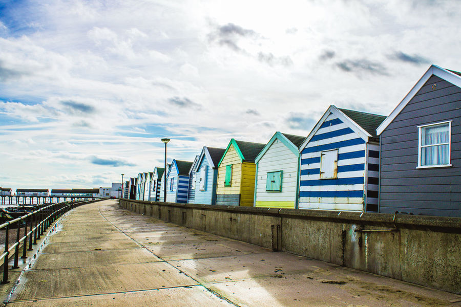 Beach Cloud - Sky Outdoors Sea Sky Day Sand Building Exterior No People Multi Colored Built Structure Horizon Over Water Architecture Beach Hut Collection Beach Huts Southwold Summer The Great Outdoors - 2016 EyeEm Awards