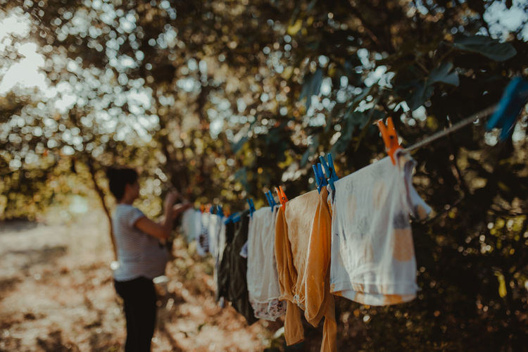 Woman drying laundry on clothesline