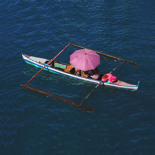High angle view of man fishing in boat