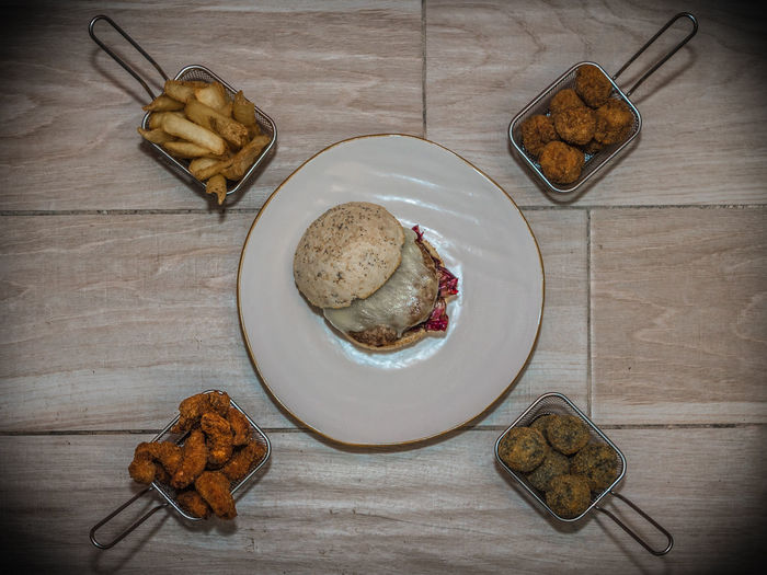 Top view on hamburger dish with french fries, chicken wings and meatballs Food And Drink Food Table Freshness Ready-to-eat High Angle View Still Life Directly Above Indoors  Bread Meal Plate Wood - Material Serving Size No People Wellbeing Healthy Eating Indulgence Baked Breakfast Snack Temptation French Food