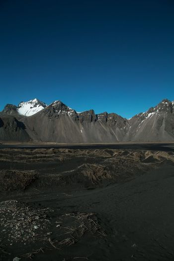 Vestrahorn Beauty In Nature Iceland Mountain Mountain Range Vestrahorn Mountain Sky Environment Landscape Scenics - Nature Beauty In Nature Tranquil Scene Nature Land No People Clear Sky Blue Snowcapped Mountain Day