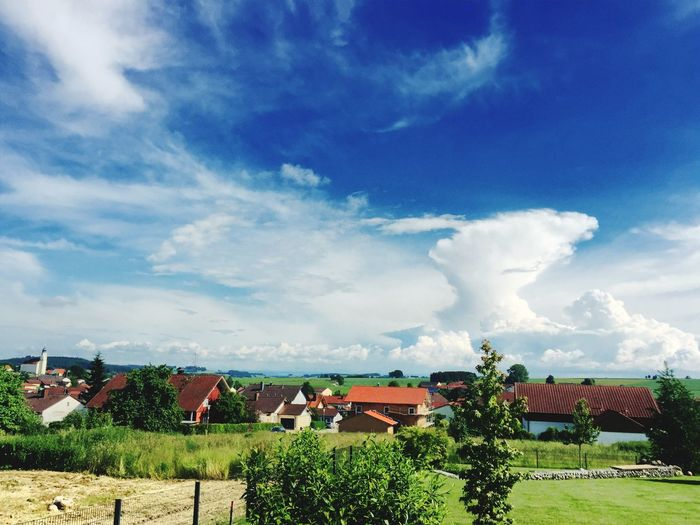 Houses on landscape against sky at passau