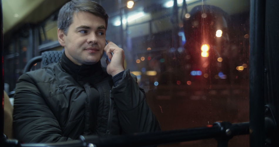 Portrait of man using mobile phone in city