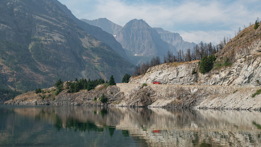 Photos from Glacier National Park in Montana. Slight haze was from wildfire smoke. Montana Mountain Goat Natural Nature Reflection Smoky Trees Cold Day Glacier Glacier National Park Glaciers Lake Landscape Mountains Nature No People Outdoors Snow Snowy Wild Wildfire Wildlife