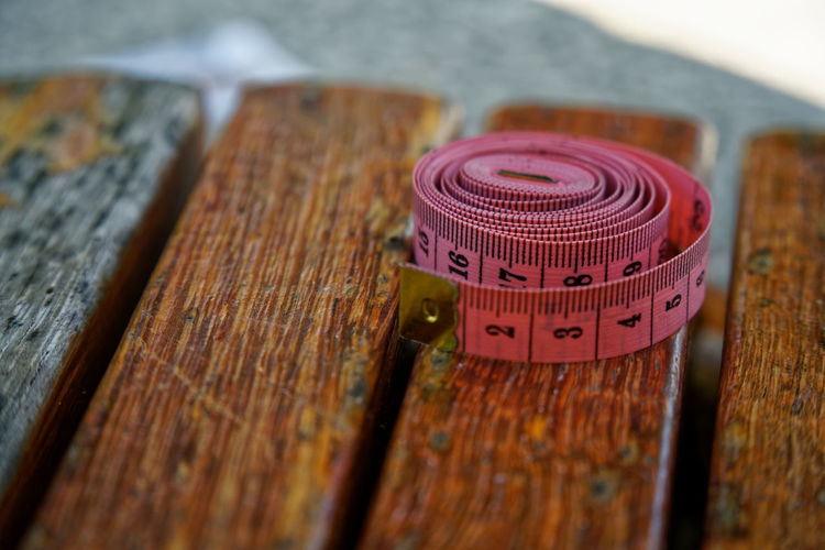 Close-up of rolled tape measure on table