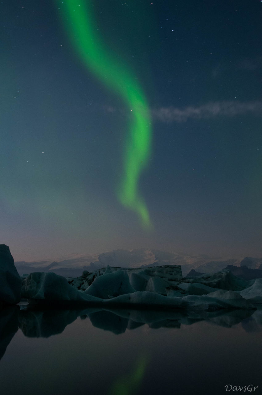 aurora polaris, beauty in nature, night, green color, reflection, nature, winter, outdoors, sky, scenics, cold temperature, tranquility, tranquil scene, lake, no people, water, astronomy, glacier, snow, frozen, star - space