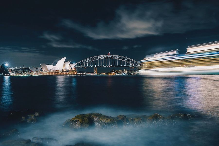 • Capturing Motion • Night Sky Illuminated Architecture Cloud - Sky Built Structure Long Exposure Outdoors Water Sea Arts Culture And Entertainment EyeEm Selects EyeEm Best Shots Sydneyoperahouse The Week On EyeEm Cityscape Sydney Opera House Sydney Australia Architecture No People Building Exterior Travel Destinations City Nature
