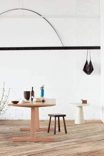 Chairs and table against white wall