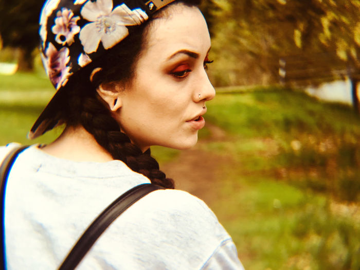 Rear view of young woman looking away in park