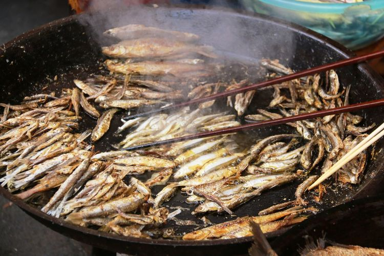 Close-up of fish frying in cooking utensil