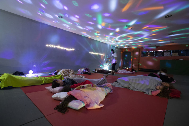 Portugal; Aula de Yoga Yogagirl Illuminated Indoors  Decoration Lighting Equipment Arts Culture And Entertainment Celebration Multi Colored Light Night Event Enjoyment Real People Group Of People Flooring Lifestyles People Electric Light Glowing Ceiling Nightlife