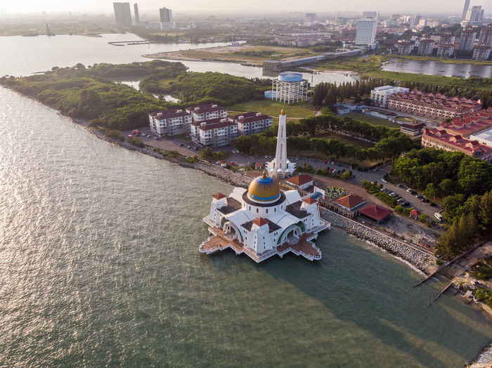 Melaka Straits Mosque, Malaysia High Angle View Architecture Building Exterior Built Structure City Nature Travel Outdoors Water Day Tree Building Plant No People Travel Destinations Development Cityscape Melaka Malacca Malaysia ASIA Mosque Drone  Droneshot Melaka Straits Mosque
