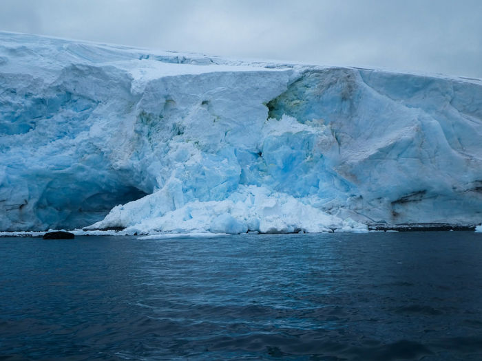 Antarctica Beauty In Nature Climate Change Cold Temperature Environment Environmental Issues Floating Floating On Water Frozen Frozen Water Glacier Glaciers Ice Iceberg Landscape Melting Nature No People Outdoors Scenics - Nature Sea Sky Snow Water Winter