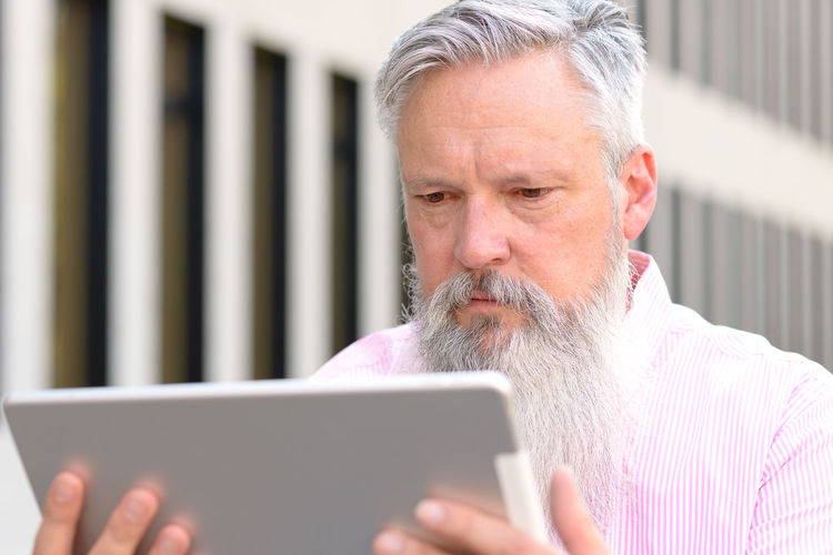Man Using Digital Tablet Outdoors