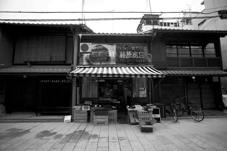 Japan Pepsi Architecture Bicycle Building Building Exterior Built Structure City Clear Sky Communication Day Kyoto Land Vehicle Mode Of Transportation Nature No People Outdoors Residential District Store Street Text Transportation Window