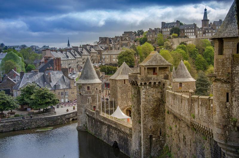 Historic buildings against cloudy sky