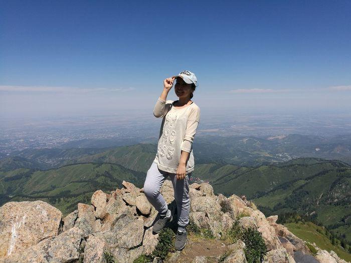 Вид с гор любимого города Hiking Hiking Trail Hikingadventures Weekend Activities Almatymountains Almaty's Beauty EyeEm Selects Mountain Nature One Person Scenics Only Women Adult Beauty In Nature Sky Mountain Range Adventure People Landscape Leisure Activity