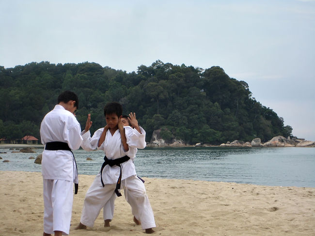 a group of school children are practicing karate on the beach Beach Boys Child Girl Island Karate Kick Martial Arts Practice Sand Sea And Sky Trening