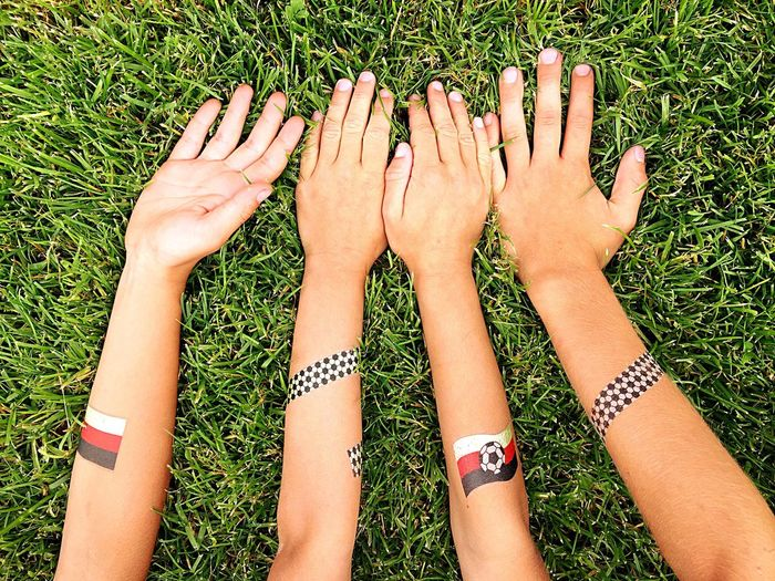 Looser Winner Worldchampionship Sports Friends Friendship Fan Soccer Germany Hands Arms Women Real People Adult Human Leg Low Section Togetherness Grass Leisure Activity Directly Above Personal Perspective