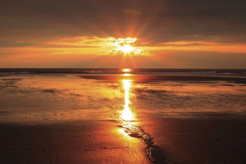 • Barmouth Sunset • Sunset Sea Scenics Beauty In Nature Sun Beach Nature Water Sky Horizon Over Water Orange Color Tranquility Tranquil Scene Reflection Outdoors Sunlight Silhouette Cloud - Sky No People Sand EyeEmNewHere