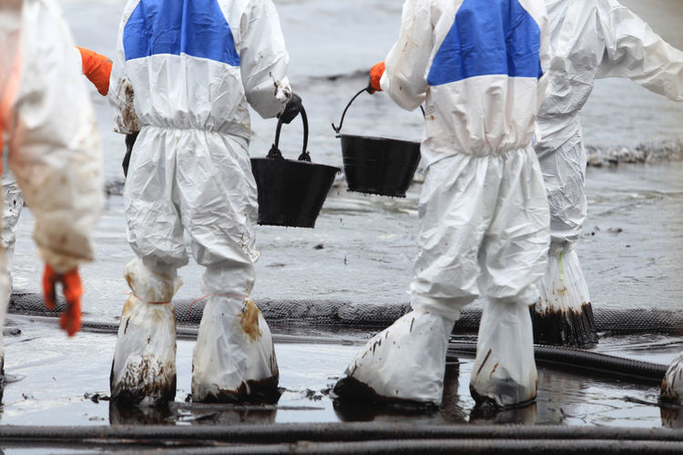 Manual workers working in dirty water