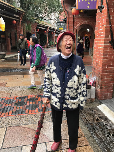Adults Only Architecture Brick Building Laughing Out Loud Old Town Outdoors People Senior Adult Senior Woman The City Light