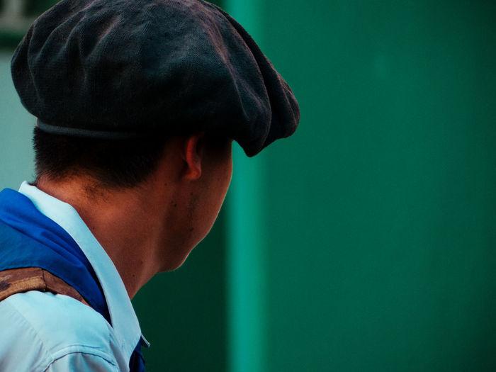 Back portrait of a man wearing beret