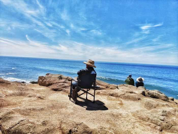 People sitting whale watching at ocean Cliff's edge. Woman Couple People Tourists Nature Creatures Sitting Chair Camp Chair Hats Straw Hat Wide Brimmed Hat Looking Out To Sea Water Sea Sitting Men Sand Togetherness Sky Horizon Over Water Cloud - Sky Calm Ocean Mid Distance Cloud Rays Headland Countryside Tranquil Scene The Mobile Photographer - 2019 EyeEm Awards The Traveler - 2019 EyeEm Awards The Great Outdoors - 2019 EyeEm Awards The Minimalist - 2019 EyeEm Awards