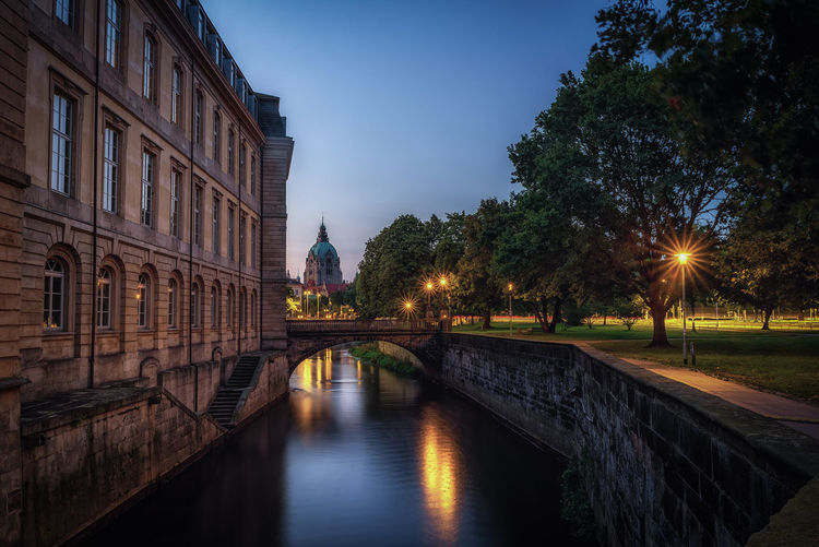 Leine castle and new town hall Building Exterior Architecture Built Structure Water Sky Illuminated Nature Building Tree City Religion Travel Destinations Place Of Worship No People Reflection Belief Plant Spirituality Dusk Canal Hannover New Town Hall EyeEmNewHere Architecture Blue Hour