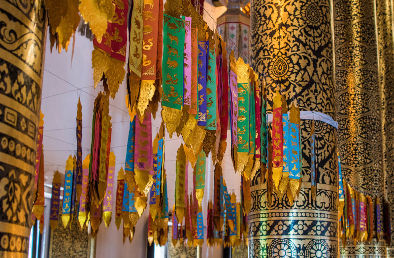 Low angle view of decorations hanging in temple