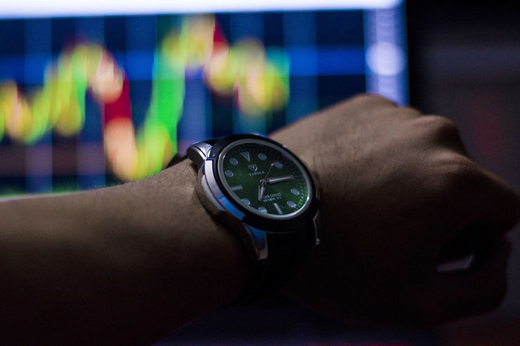 See stock chart time Human Hand Human Body Part Wristwatch Hand Watch Time One Person Real People Body Part Men Indoors  Lifestyles Wrist Close-up Human Joint Instrument Of Time Checking The Time Focus On Foreground Leisure Activity Human Limb Clock Human Arm Finger Personal Accessory See Stock Chart Time