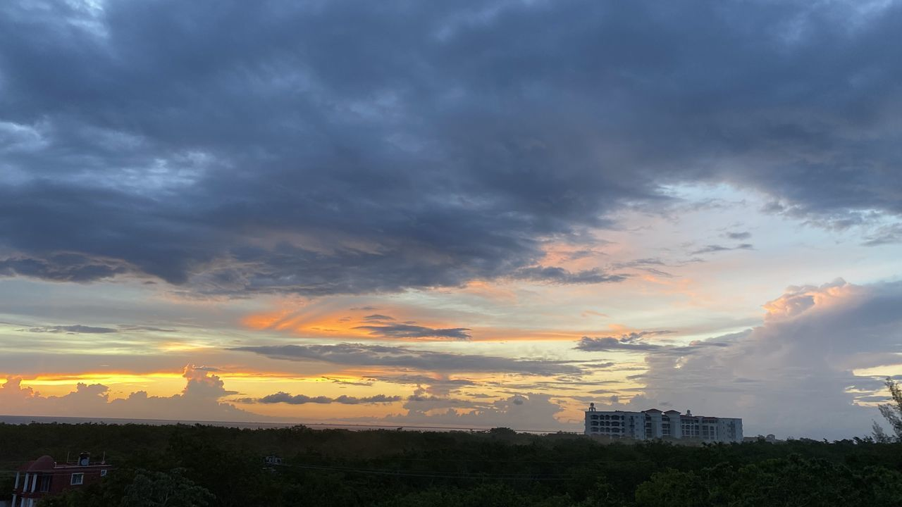 BUILDINGS AGAINST SKY AT SUNSET