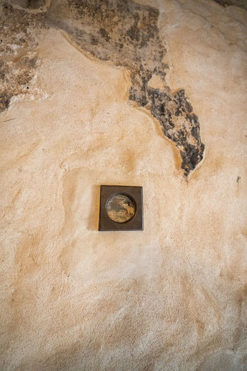Close-up of hole on wall