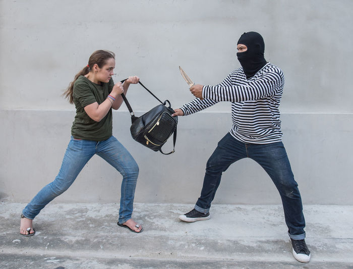 Thief stealing bag of woman