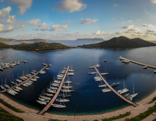 Aerial view of marina with lots of yachts. Water Sky Nautical Vessel Cloud - Sky Mode Of Transportation Transportation Mountain Scenics - Nature Nature No People Sea High Angle View Day Outdoors Beauty In Nature Tranquil Scene Tranquility Moored Bay Port Drone  Aerial View Marina Yacht Ship Boat