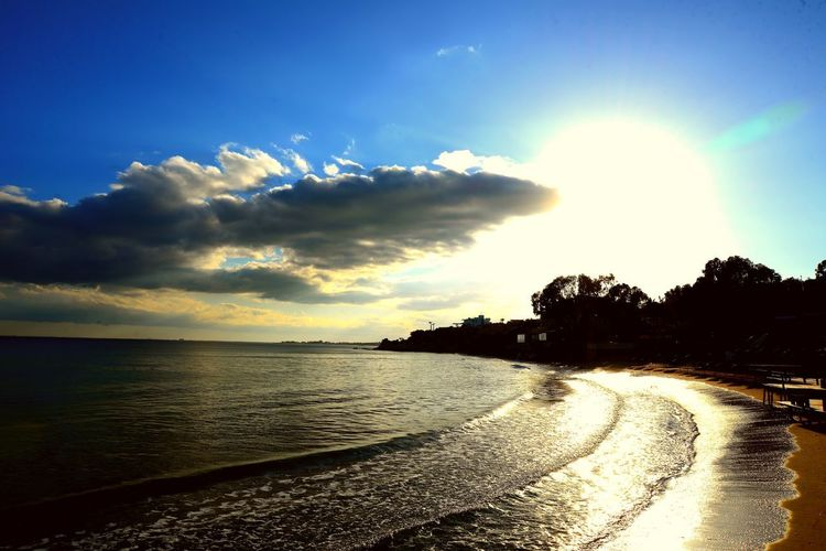 Beach Beauty In Nature Bright Cloud - Sky Horizon Horizon Over Water Land Lens Flare Nature No People Outdoors Plant Scenics - Nature Sea Sky Sun Sunbeam Sunlight Sunset Tranquil Scene Tranquility Tree Water