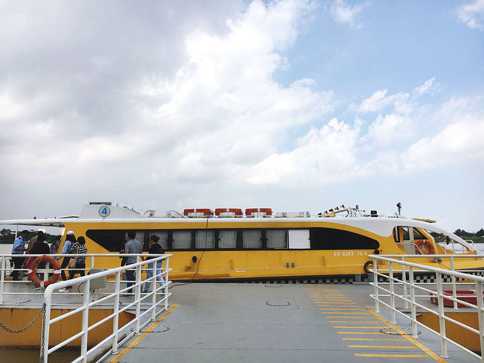 Yellow ship against sky
