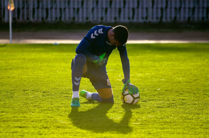 Man playing with ball on field