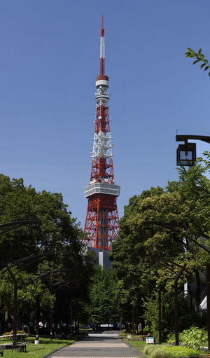 Minato-ku, Tokyo, is a distant view from the Shiba Park. Architecture Blue Built Structure Day Grass Green Color Growth Japan Nature No People Outdoors Road Sky Tall Tall - High The Way Forward Tokyo Tourism Tower Travel Destinations Tree
