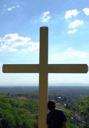 Christianity Cloud - Sky Cross Day One Person Outdoors Person Leaning Real People Rear View Reflecting Scenics Sky Trust Wooden Cross