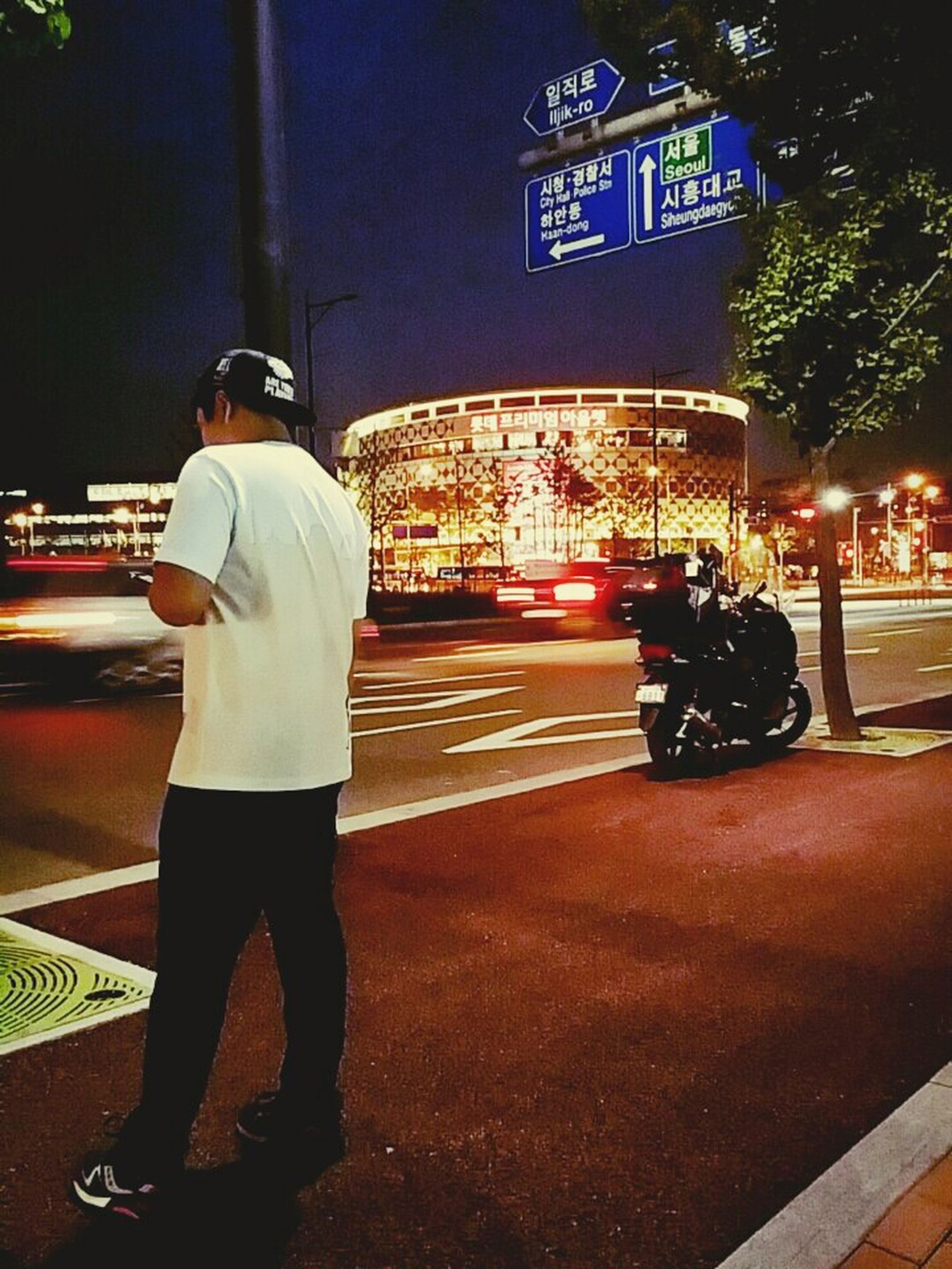 transportation, men, night, lifestyles, rear view, illuminated, city life, street, city, full length, communication, mode of transport, leisure activity, casual clothing, land vehicle, travel, text, standing